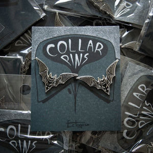 Spooky enamel pins of bats for the collar and lapel of jackets.