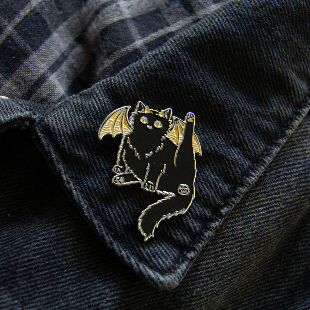 A black cat butt enamel pin for alternative fashion.
