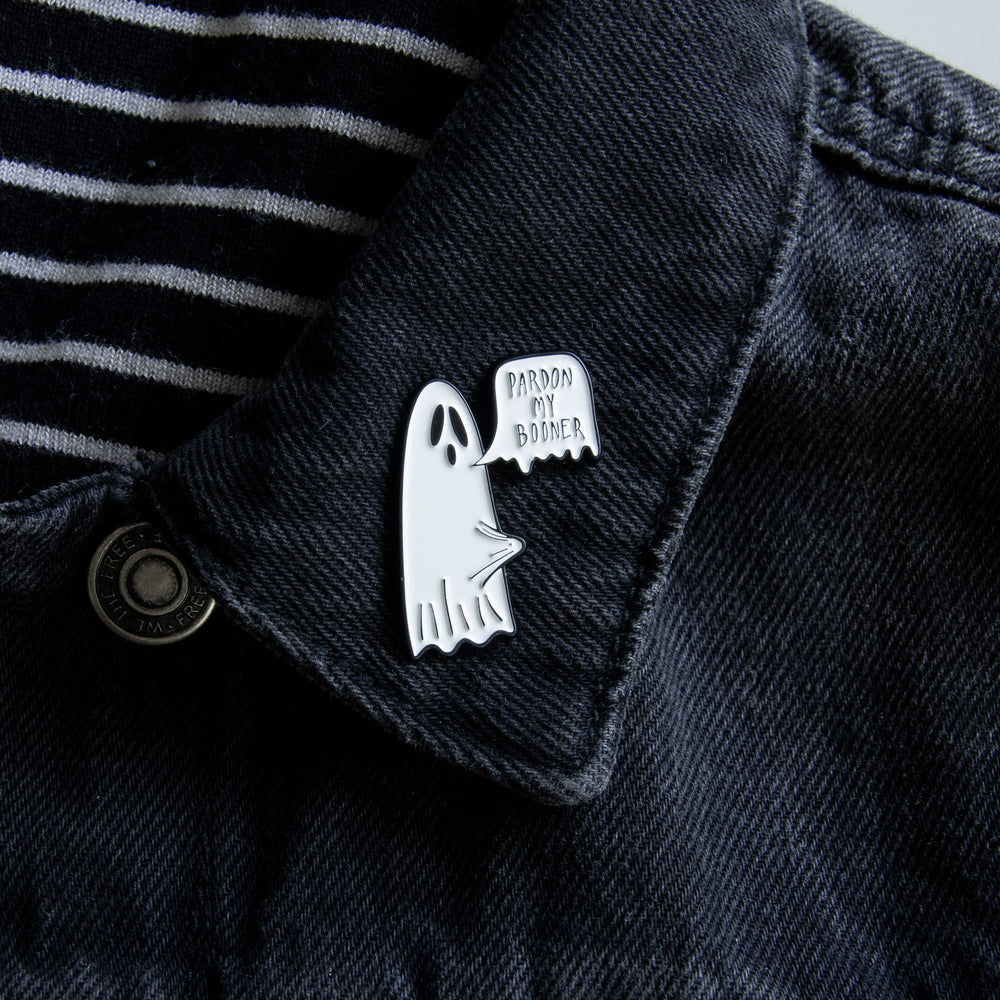 A funny enamel pin of a ghost with a boner, in black and white.
