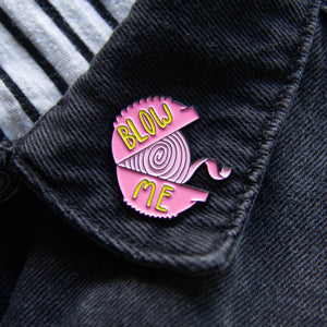 "A snarky lapel pin for men and women of bubble gum with the quote, ""blow me""."