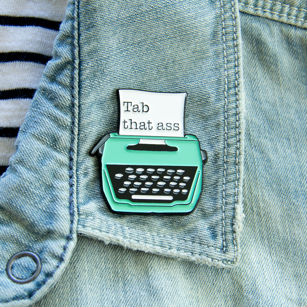 A lapel accessory for writers. Worn on a denim jacket for geek chic style.