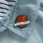 A Mars planet themed enamel pin for men and women interested in NASA and space travel.
