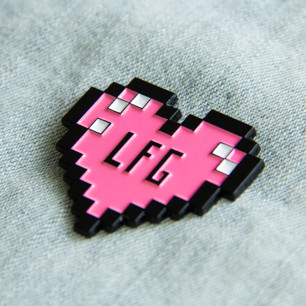 An MMO gamer lapel pin of a health heart meter.