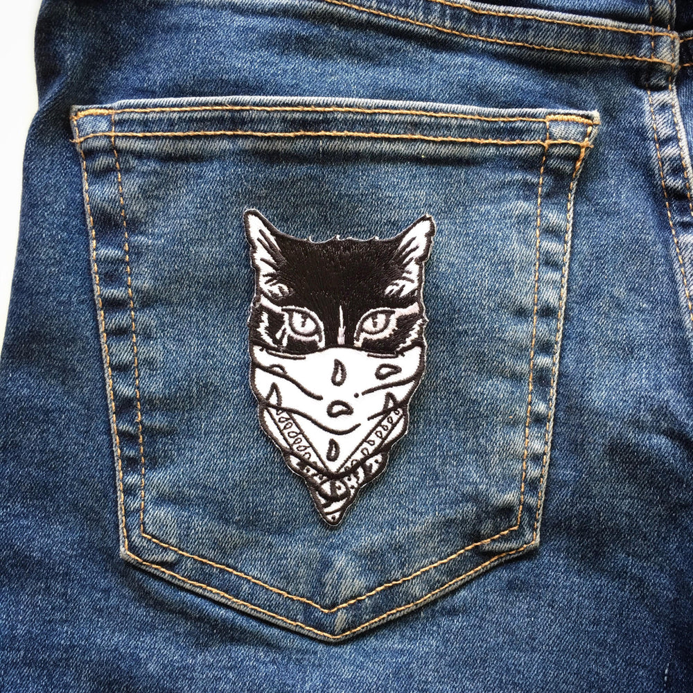 A cool gangster cat patch on the back of jeans for unisex streetwear.