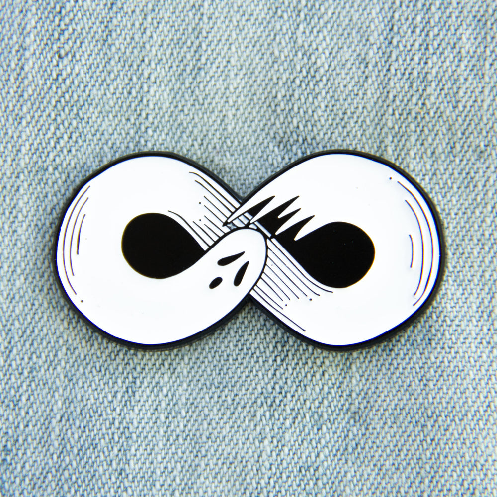 A horror themed enamel pin of a ghost in the shape of an infinity sign for Halloween.