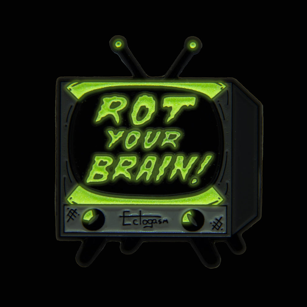"A glow in the dark TV set enamel pin with the quote, ""Rot Your Brain!"" in spooky letters."