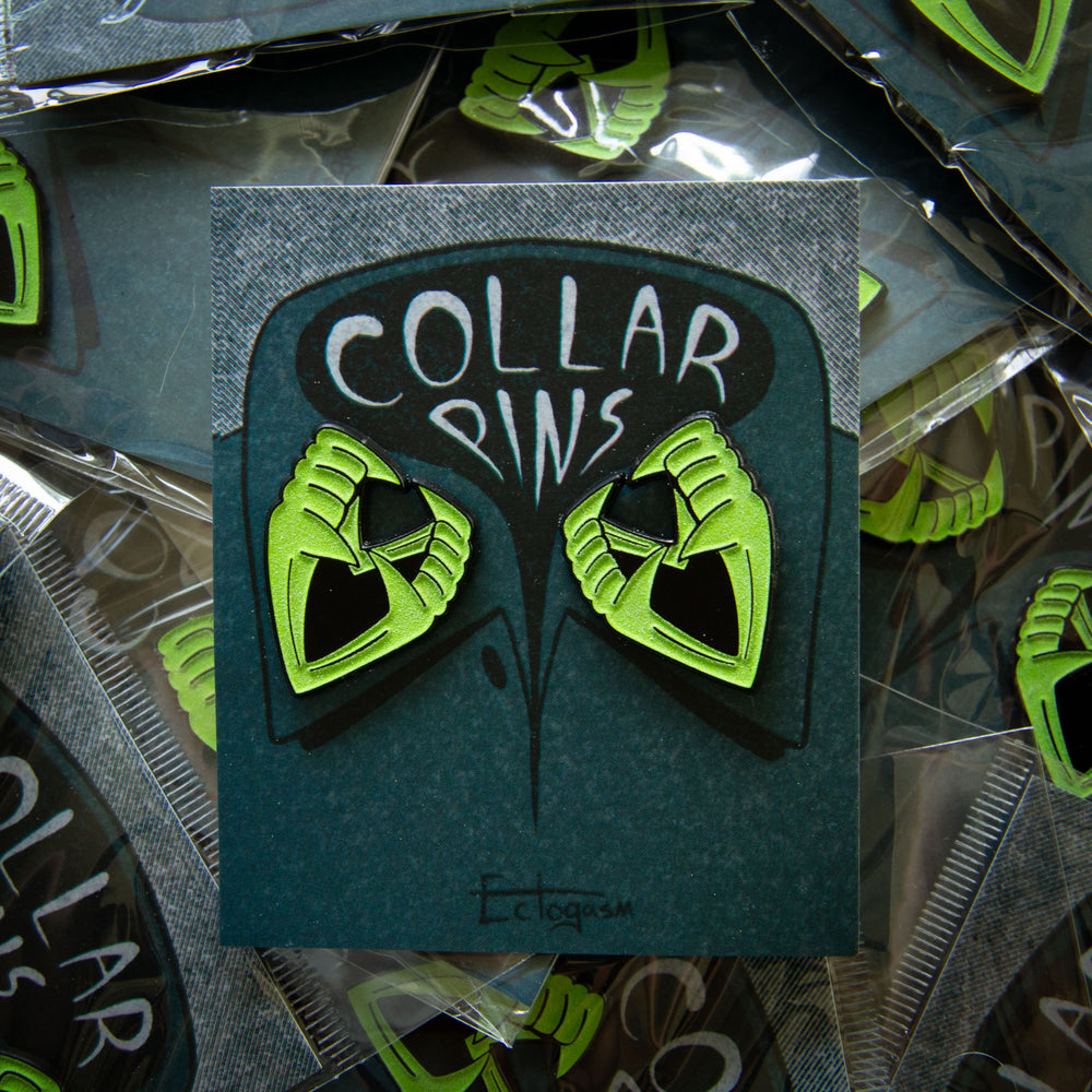 Ectogasm fake vampire teeth enamel pins in glow-in-the-dark green.