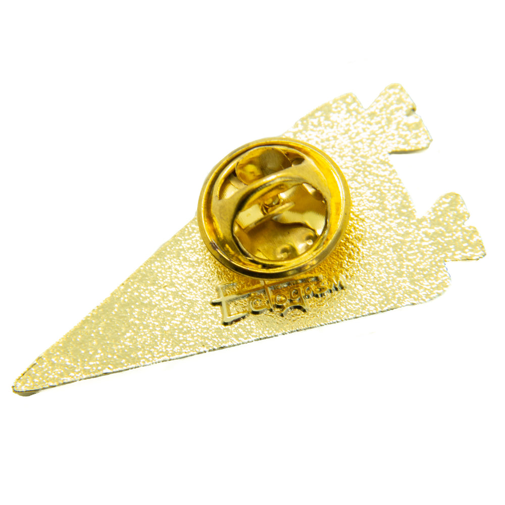 The metal clasp on the back of a gold enamel pin. This collectible accessory has the artist's signature stamped on the back.