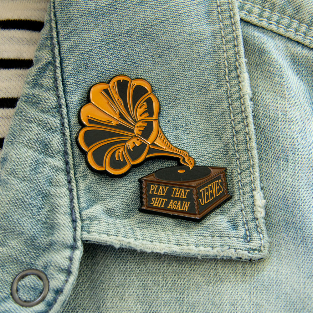 A lapel pin with a funny quote for musicians and record player fans.