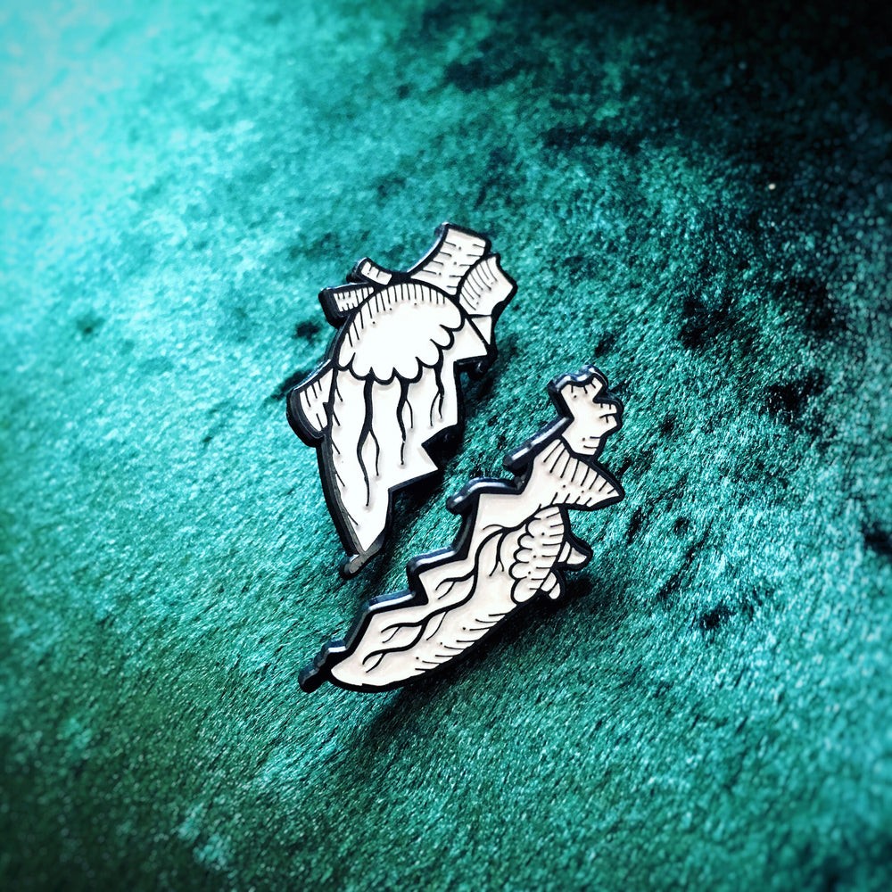 A wholesale enamel pin set of an anatomical human heart. Perfect for goth and punk couples.