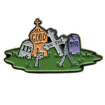 A cool lapel pin of headstones with skeleton hands popping up from the ground.