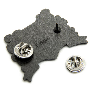 Two metal clasps on the back of an Ectogasm lapel pin.