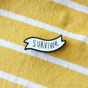 "a banner pin with the positive quote, ""survivor""."
