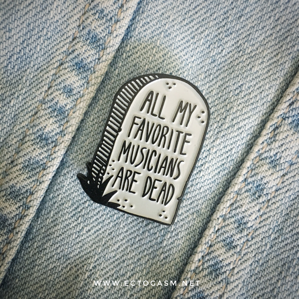 A music lapel pin worn on a denim jacket.