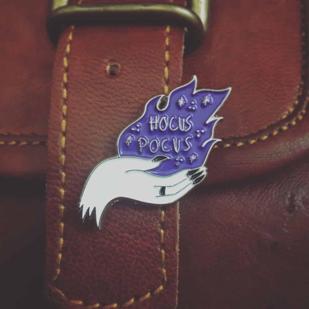 a cool Hocus Pocus pin for Halloween on a leather purse.