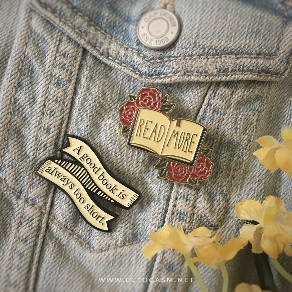 A nerdy collection of book pins on a jacket.