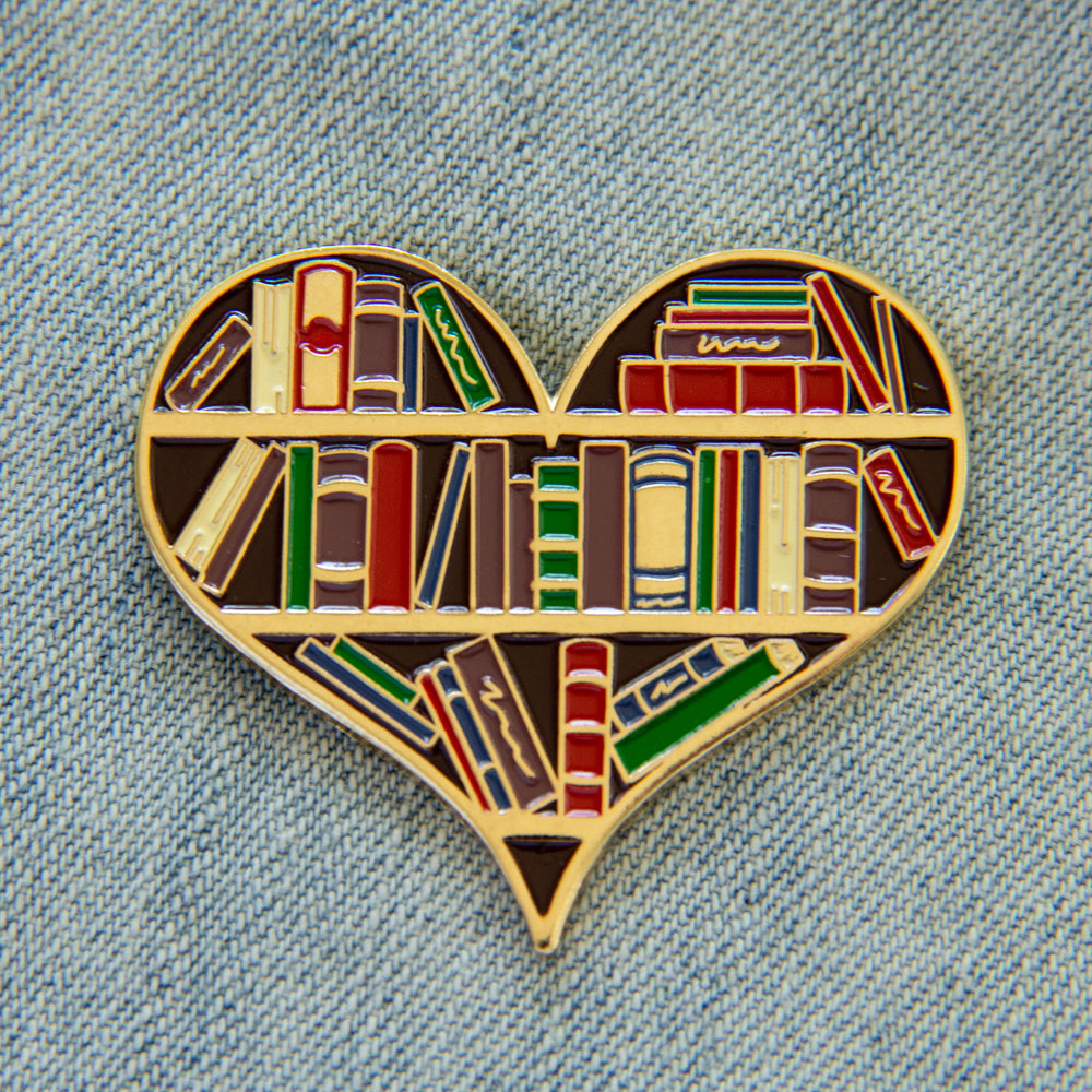 Library book shelf enamel pin in gold.