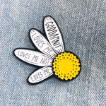 "A cute and funny enamel pin of a daisy with plucked petals. Those remaining read, ""Loves me, loves me not, loves me, Goddamnit""."
