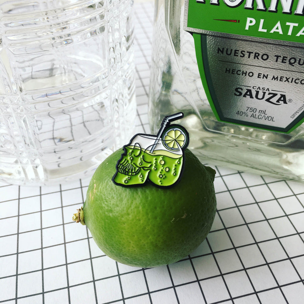 A punk fashion enamel pin for bartenders.
