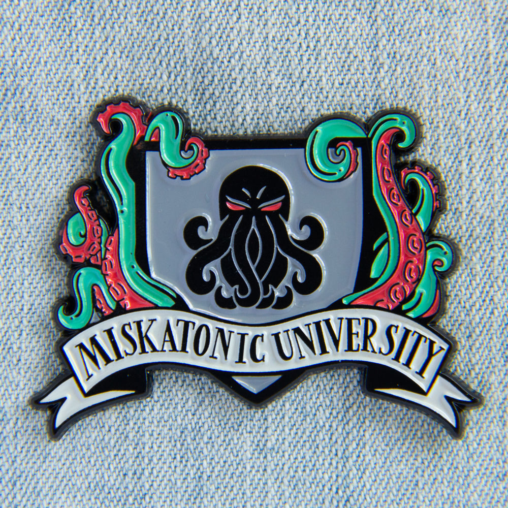 A unisex H.P. Lovecraft themed pin with tentacles and the Miskatonic University crest.