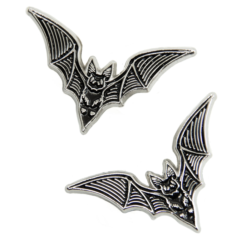 A cute set of black and silver bat enamel pins.
