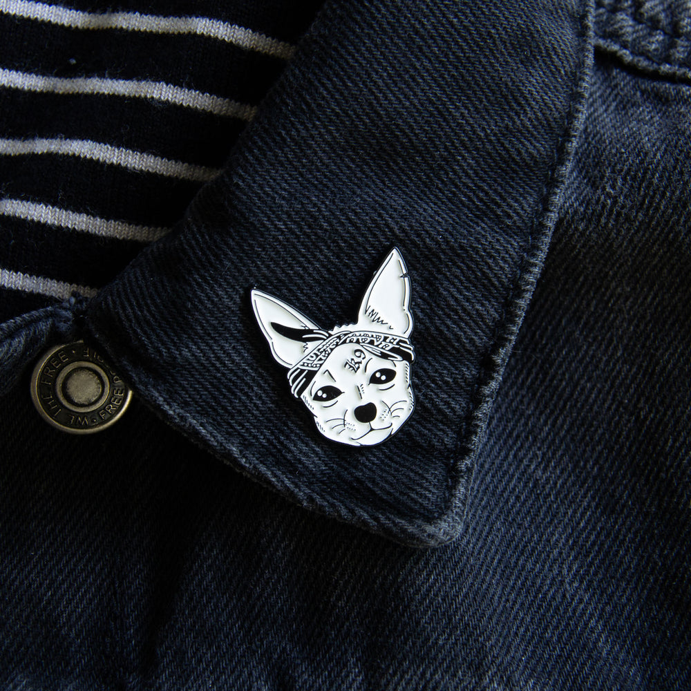 A unisex dog accessory worn on a jacket lapel.