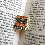 A literary themed lapel pin inside of a book.