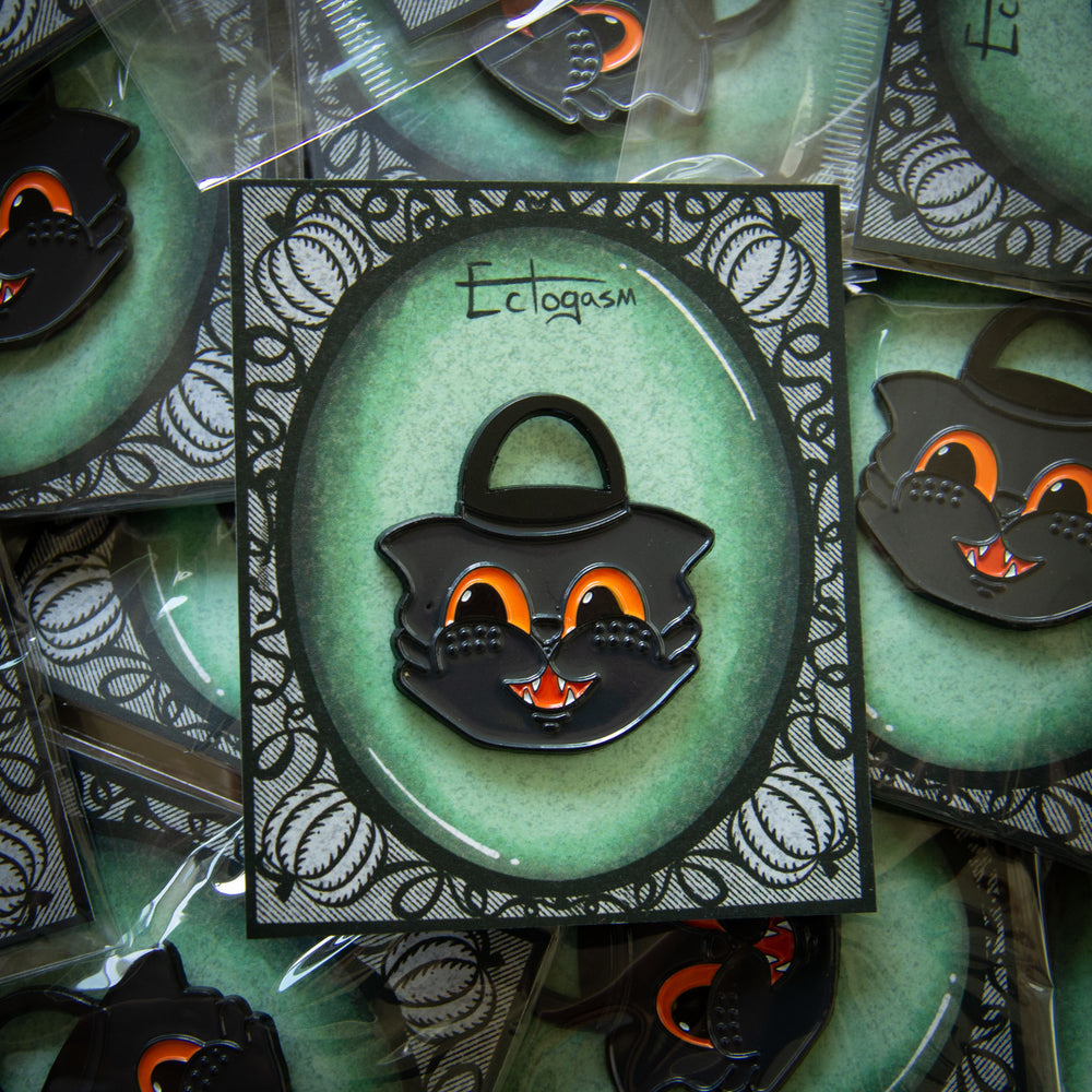 A vintage cartoon black cat enamel pin for Halloween.