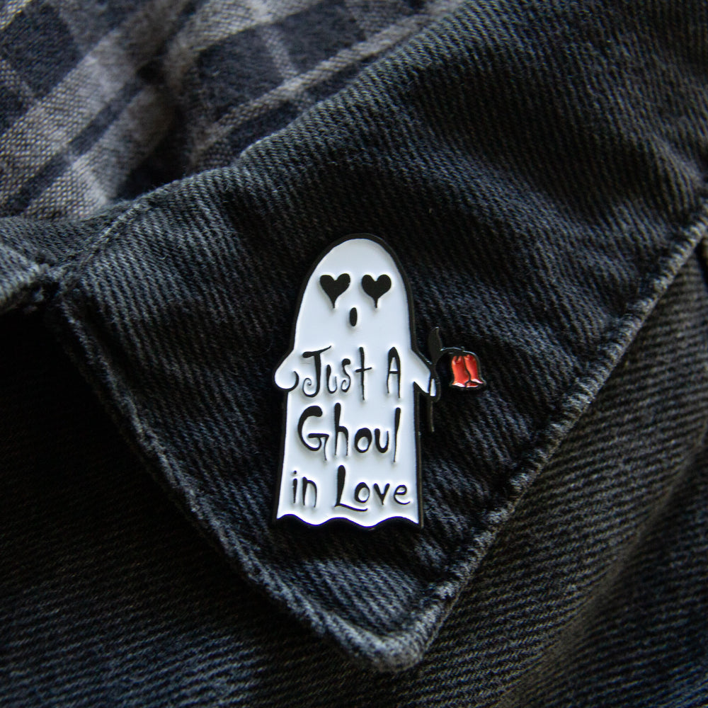An adorable ghost enamel pin with a romantic quote.