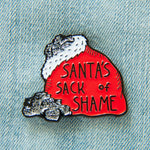 An enamel pin of Santa's sack full of coal with a funny quote.