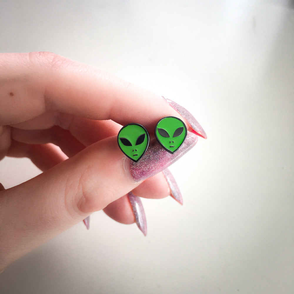 Small, comfortable enamel earrings of aliens for celestial style.