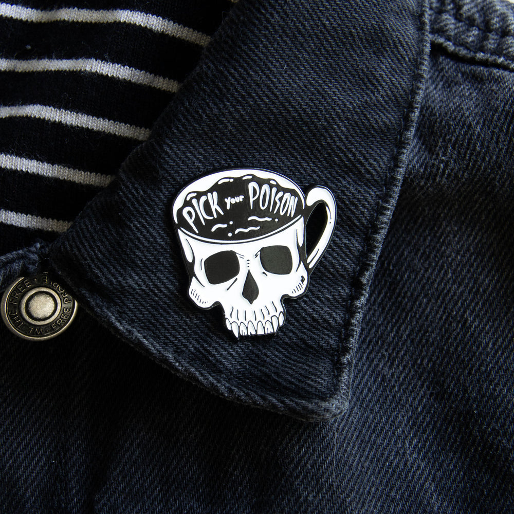 A punk tea and coffee themed enamel pin of a skeleton skull.