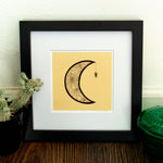 A witchy, spiritual art print of a moon with a spider's web.