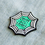 A women's lapel pin for creepy cute goth fashion.