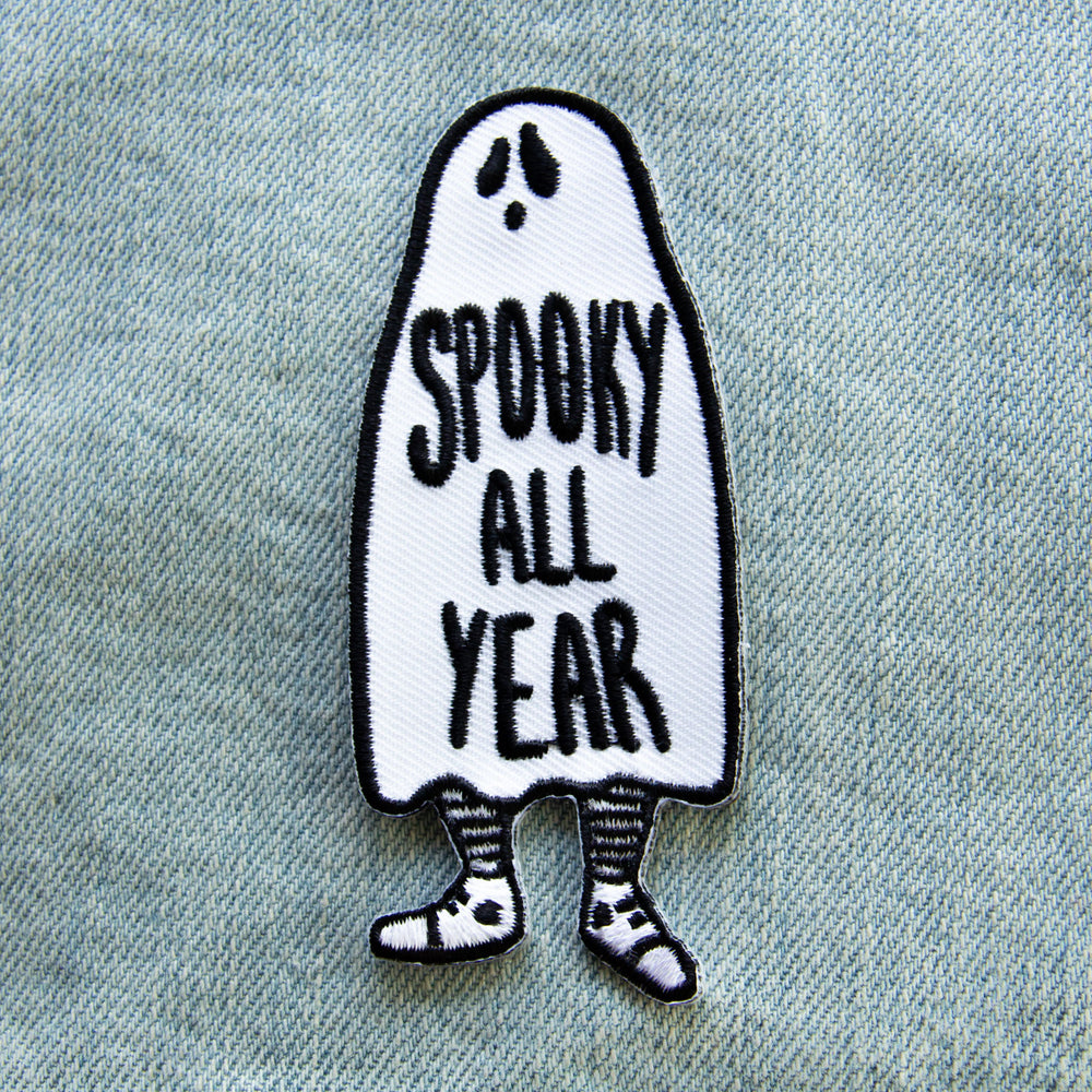 "A Halloween themed iron on patch of a ghost with the quote, ""Spooky All Year"" in black and white."