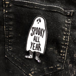 "A black and white canvas patch of a ghost with the quote, ""Spooky All Year"" on a pair of black jeans."
