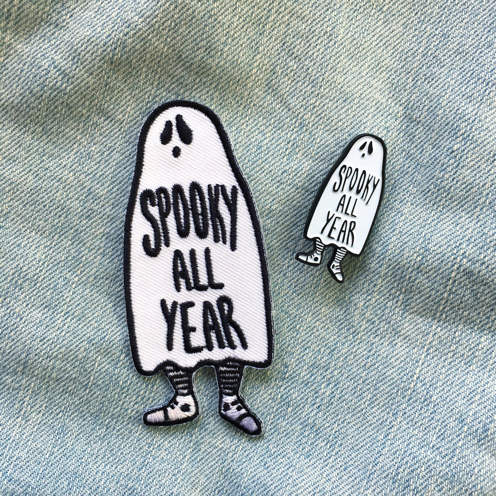 "A ""Spooky All Year"" Gothic ghost enamel pin and matching patch."