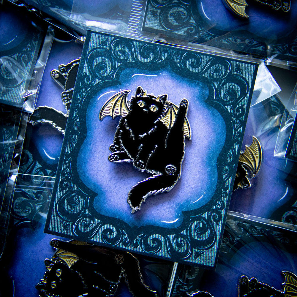 A witchy enamel pin of a black cat.
