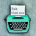 An enamel pin for writers with a funny quote.