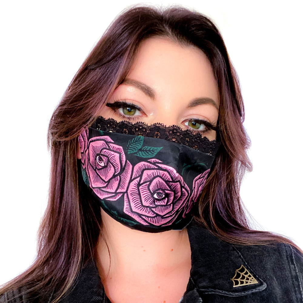 A pretty face mask printed with pink roses drawn in a tattoo style for women's fashion.