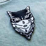 A trendy black and white cat patch with an iron on backing.