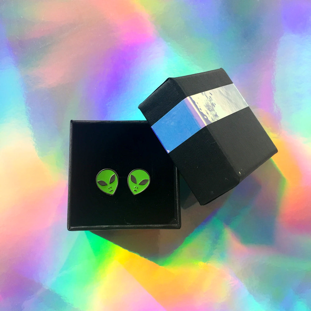 Ectogasm alien stud earrings in a cute, holographic gift box.