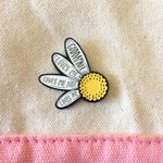 A pretty daisy accessory with a funny quote, pinned to a tote bag. Great for grunge teen fashion.