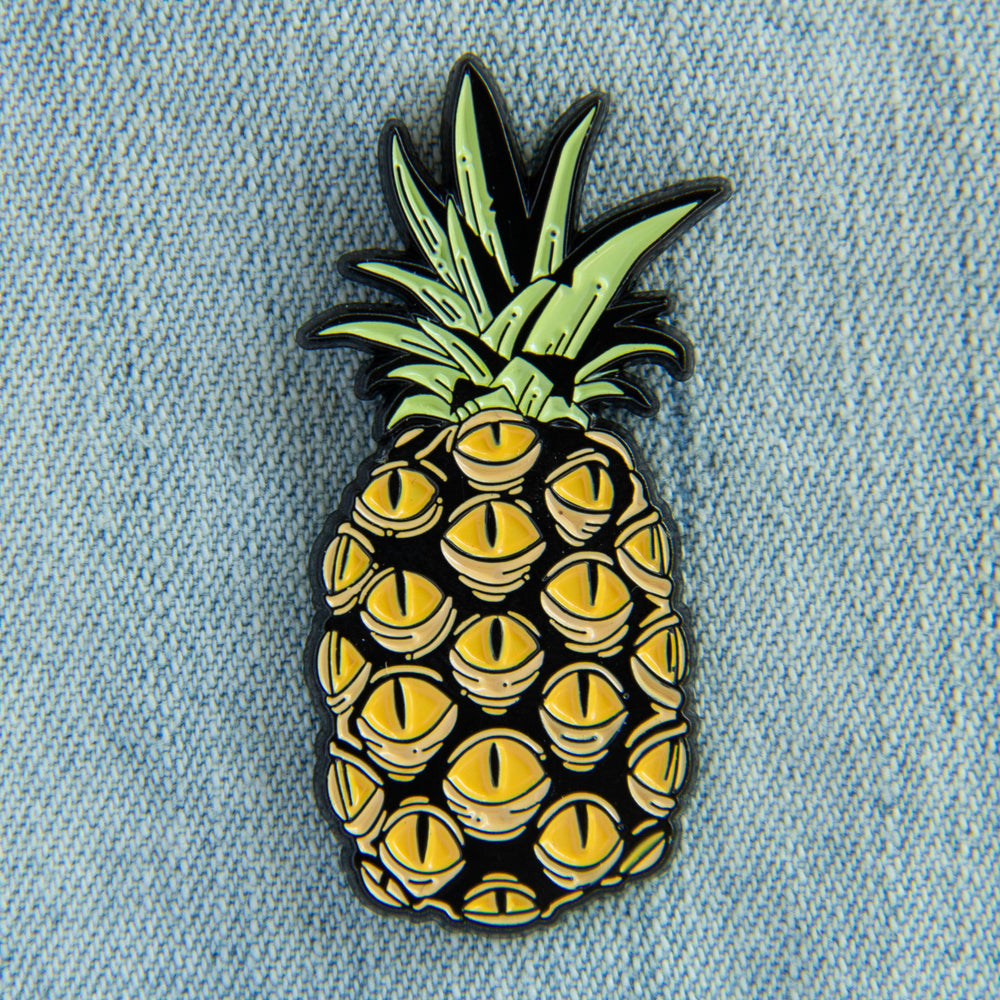 An oddity inspired accessory of a pineapple with creepy yellow eyes.
