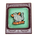 Feline themed packaging on a devil cat enamel pin, designed by artist Ectogasm.