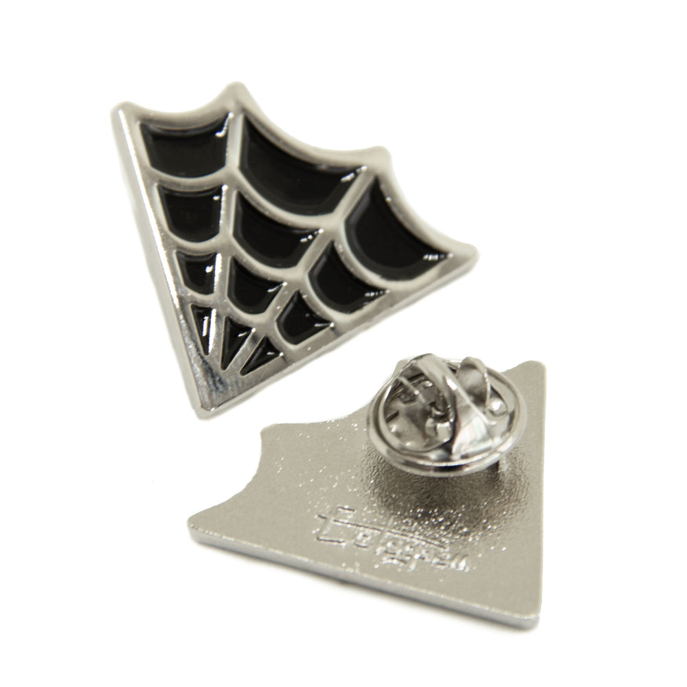 Spooky spiderweb collar pins for Halloween fashion.
