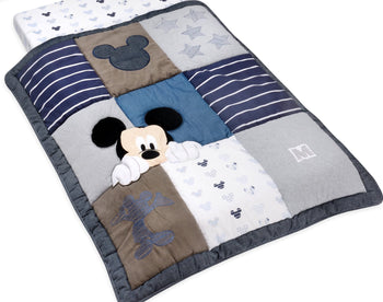 products/mickey_mouse_90_years_of_magic_quilt.jpg