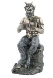 Pan Sitting On The Rock Playing Pan Flute