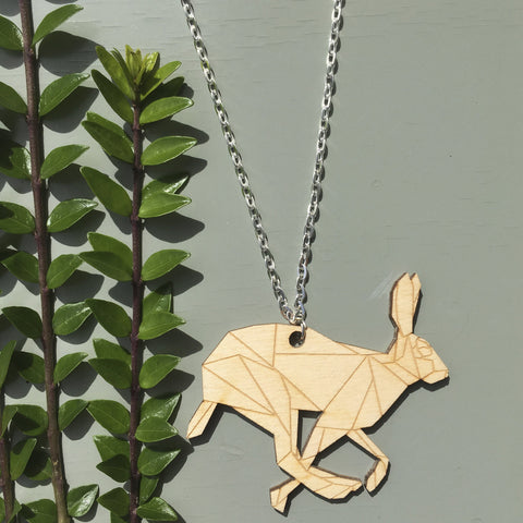 Laser cut Geometric Running Hare Pendant Necklace on a long silver plated chain by Stencilize.