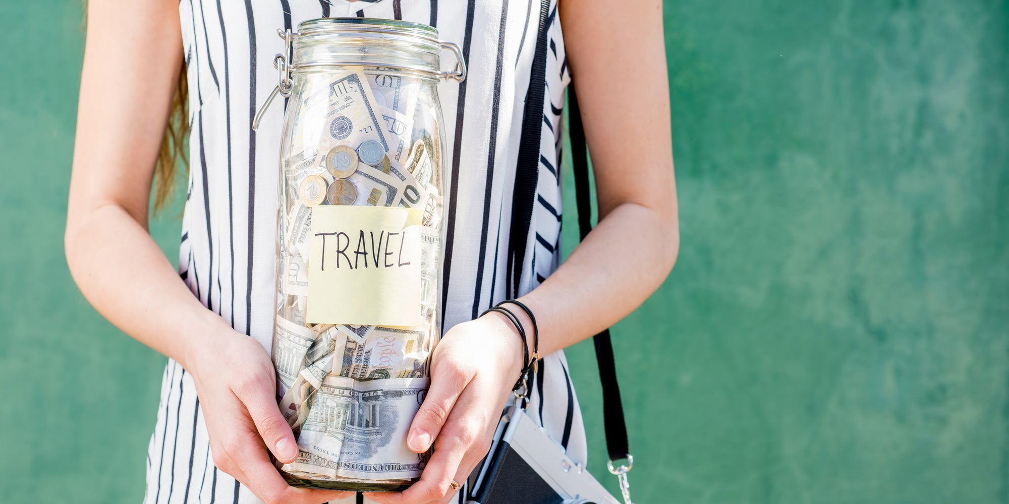 Woman holding travel jar